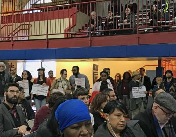 Demonstrators hold signs showing their support for a supervised injection facility for drug users in Philadelphia. (Joel Wolfram/WHYY)
