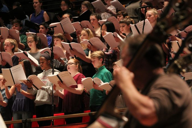 The Westminster Symphonic Choir, the Keystone State Boychoir, the Pennsylvania Girlchoir, and the Sister Cities Girlchoir, perform with the Philadelphia Orchestra. (Emma Lee/WHYY)