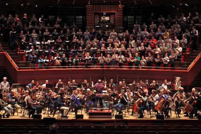 The Philadelphia Orchestra teams up with 250 singers from four choirs during a rehearsal for