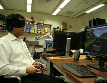 Brian Smith plays a racing game blindfolded. He made a user interface for blind players to drive in video games, just like sighted players. He tested it with blind volunteers, as well as blindfolded sighted volunteers.