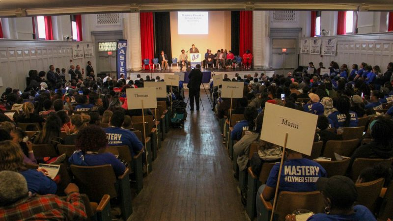 Hundreds of parents and students fill the auditorium at Mastery Shoemaker charter school for an assembly focused on reducing gun violence and funding charter schools. (Emma Lee/WHYY)
