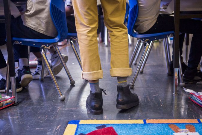 Hayes frequently connects with students through pop culture, sports and style. (Jessica Kourkounis/WHYY)