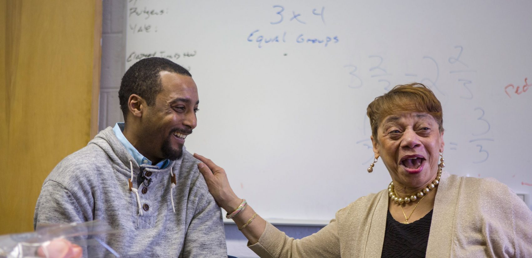 Jovan Weaver and Marie Brown, who was his tenth-grade geometry teacher at Abraham Lincoln High School. (Jessica Kourkounis/WHYY)