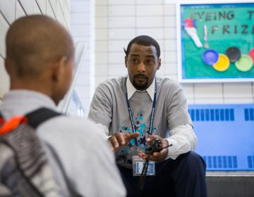 Jovan Weaver speaking to a student at Wister Elementary on the first day of school in August 2016. (Jessica Kourkounis/WHYY)