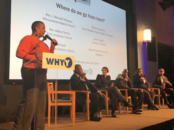 WHYY's Annette John-Hall leads a panel of social justice advocates on stage at WHYY. From left, Rev. J. Wendell Mapson of Monmental Baptist Church, Rev. Abbey Tennis of First Unitarian Church, Asa  Khalif of Black Lives Matter, Nijmie Dzurinko of the Pennsylvania Poor People's Campaign, and Tamir Harper of UrbEd. (Sandra Clark/WHYY)