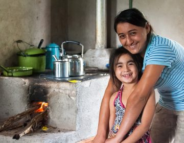 Many communities rely on inefficient and dirty wood fired stoves to cook. A common carbon offset project is to supply communities with cleaner, more efficient stoves. For recipients, like this family in Honduras, it saves time and money, as well as carries health benefits. (Courtesy of Cool Effect)