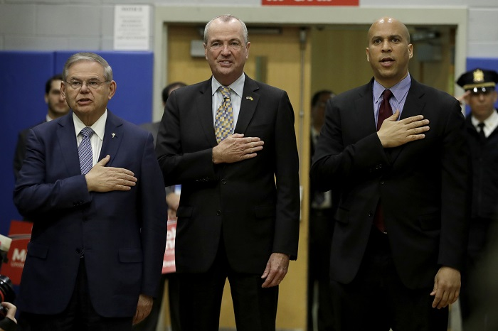 U.S. Sen. Bob Menendez, left, New Jersey Gov. Phil Murphy and Sen. Cory Booker attend an event kicking off Menendez's campaign for re-election at Union City High School, Wednesday, March 28, 2018, in Union City, N.J. (AP Photo/Julio Cortez)