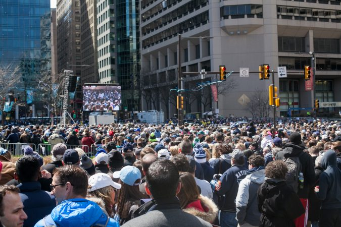 Thousands gathered around City Hall at the end of the parade route for the NCAA Champion Villanova WIldcats Thursday morning. (Brad Larrison for WHYY)