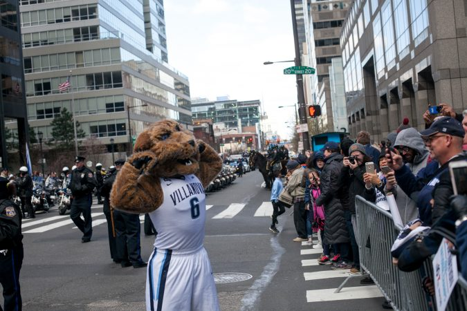 The Villanova mascot Wil D. Cat pumped up fans before the teams parade to celebrate their NCAA Championship Thursday Morning on Market Street. (Brad Larrison for WHYY)
