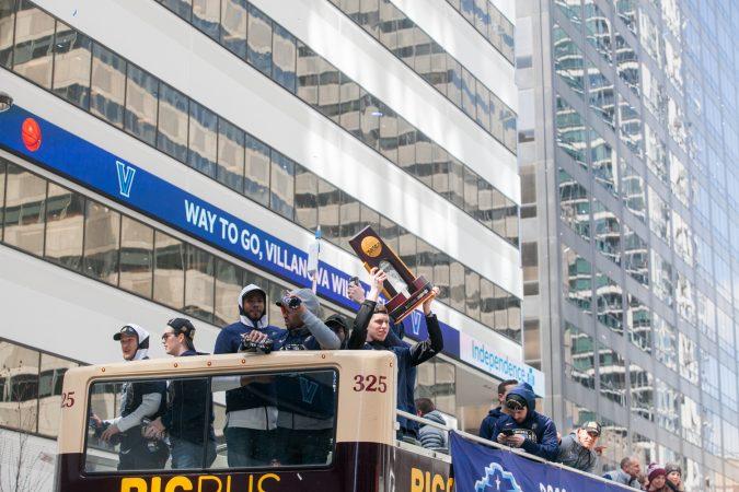 The NCAA Champion Villanova WIldcats basketball team ride down Market Street during their parade Thursday morning. (Brad Larrison for WHYY)