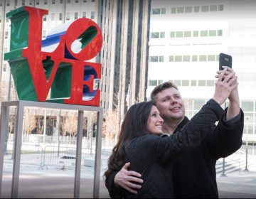 A couple poses at Love Park in February.  (Courtesy of Philadelphia Department of Parks and Recreation)