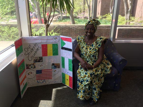 Aminata Sy sits at Penn's Van Pelt Library. (Photo courtesy of Aminata Sy)
