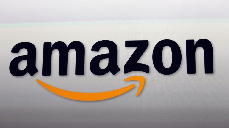 The Amazon logo in Santa Monica, Calif. Amazon Web Services has government contracts that show its influence is far beyond the Post Office. (Reed Saxon/AP)