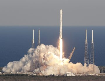 A SpaceX Falcon 9 rocket transporting the TESS satellite lifts off at the Cape Canaveral Air Force Station in Florida on Wednesday. The satellite will scan nearly the entire sky for alien worlds. (John Raoux/AP)