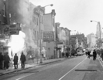 Fire shoots out from a Baltimore store on Gay Street as looting erupted in a five-block business section in Baltimore on April 6, 1968. Police sealed off the area. (AP)