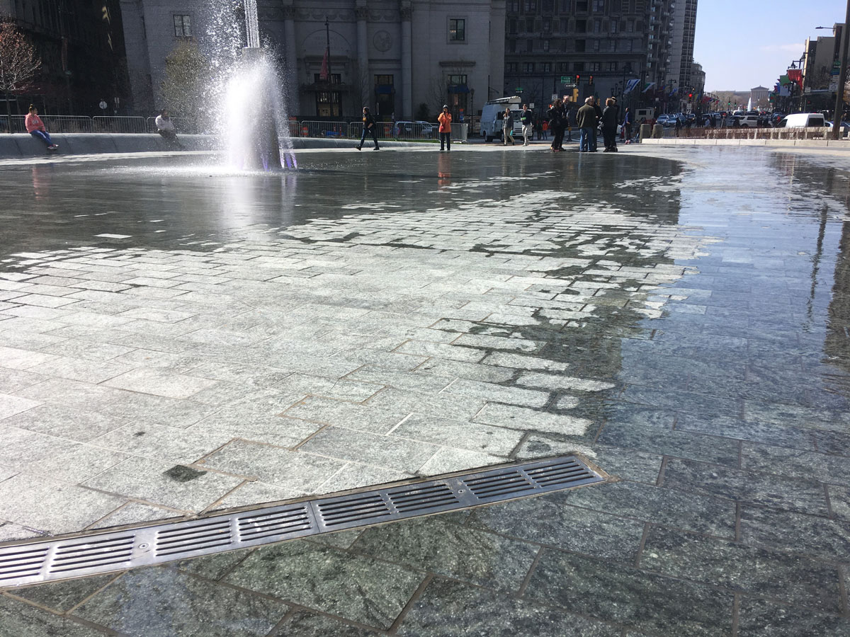 During initial testing of LOVE Park's new water features, water flowed around the drains and onto sidewalks that were meant to remain dry