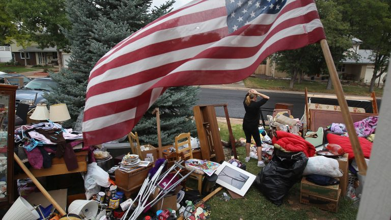 Julie Holzhauer stands among her family's possessions after being evicted from her home in Centennial, Colo., in 2011. (John Moore/Getty Images)