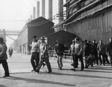 Steelworkers leave a plant at the end of their shift in Bethlehem, Pa., in 1947. Employment in the industry has declined by 80 percent from its peak six decades ago, according to author Douglas Irwin. (Hulton Archive/Getty Images)