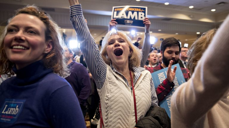 Supporters cheer at an election night rally in Canonsburg, Pa., for Democrat Conor Lamb, whose victory got a boost from suburban voters. (Bloomberg via Getty Images)