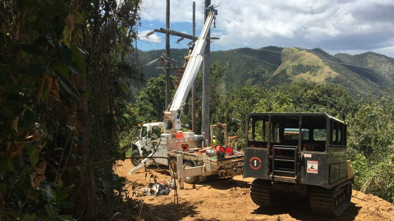 Contractors working to restore power in Cayey, Puerto Rico, last week, the same region where a falling tree interrupted a main transmission line Thursday, plunging 840,000 customers into darkness. (Adrian Florido/NPR)