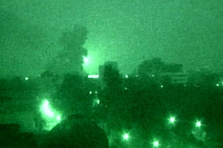 A cloud of smoke rises following a U.S.-led air strike attack near Baghdad on arch 20, 2003.