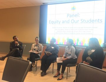 Former U.S. Education Secretary John B. King Jr. (left) holds a panel discussion about funding disparities in Delaware schools during a summit this week near Newark. (Cris Barrish/WHYY)