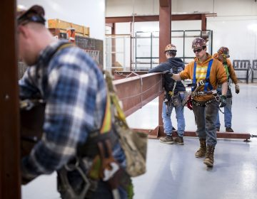 Garret Morgan (center) is training as an ironworker near Seattle and already has a job that pays him $50,000 a year. (Sy Bean/The Hechinger Report)