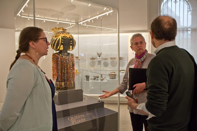 Jane Hickman, an expedition editor, explains to visitors how wealthy Queen Puabi was to have been buried in so much jewelry. (Kimberly Paynter/WHYY)