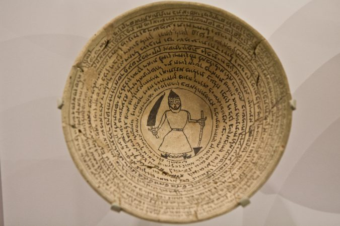 Bowls with incantations written in Aramaic were buried near doorways to trap evil spirits. (Kimberly Paynter/WHYY)