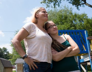 Katiena Johnson stands with her daughter Destini, who was released from jail in August. Katiena and her husband Roger took care of their grandchildren while Destini was struggling through her addiction. Destini, 27, recently regained consciousness after suffering a dozen or so strokes as a result of her latest opioid overdose. (Seth Herald for NPR)