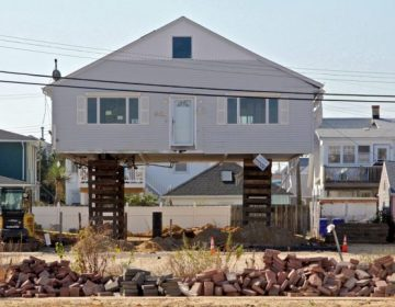 An Ortley Beach bungalow is raised. (Emma Lee/WHYY)