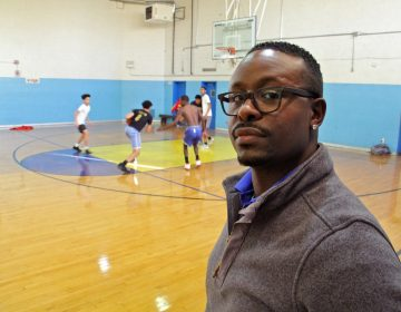 Trainee Quan King looks in on the open gym at Cobbs Creek Rec Center.