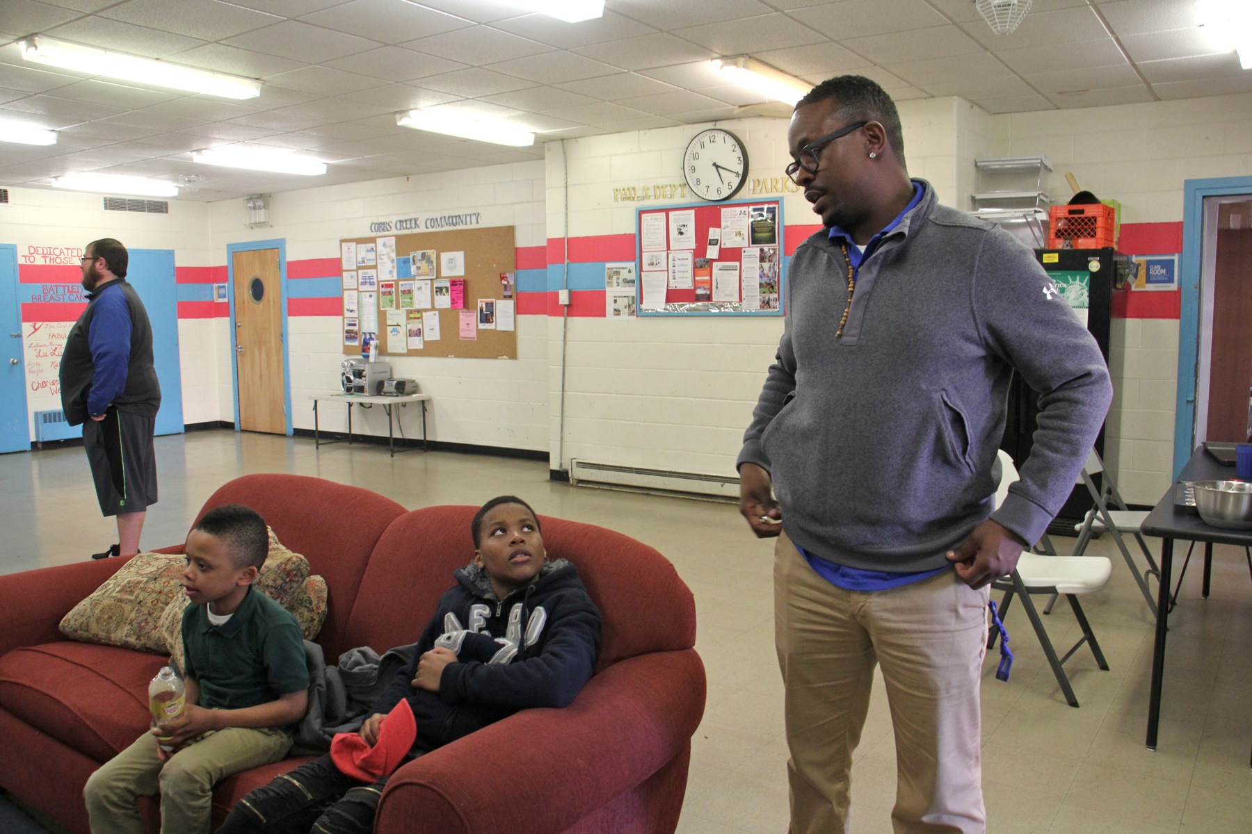 Trainie Quan King stops to chat with some youngsters at the Cobbs Creek Rec Center. (