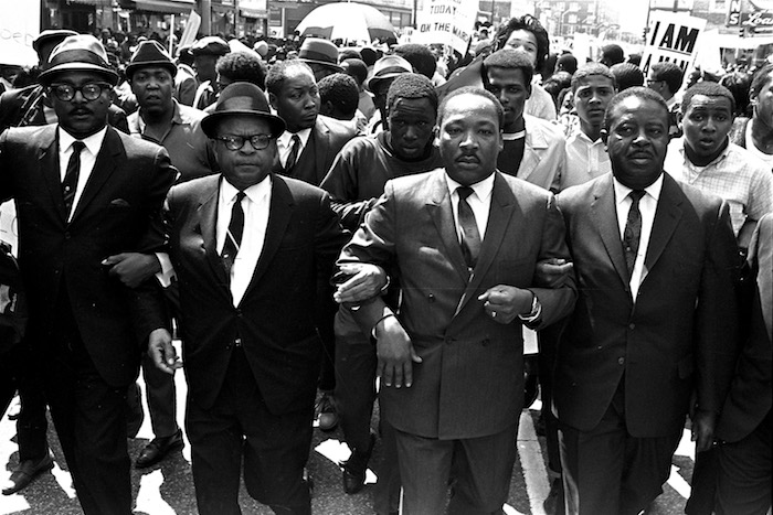 The Rev. Ralph Abernathy, right, and Bishop Julian Smith, left, flank Dr. Martin Luther King, Jr., during a civil rights march in Memphis, Tenn., March 28, 1968.  (AP Photo/Jack Thornell)