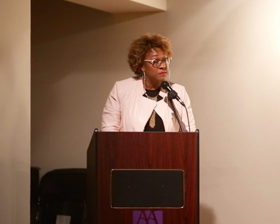Aja Graydon Dantzler, a singer-songwriter with the R&B group Kindred the Family Soul, discusses her father's complicated legacy at The African American Museum in Philadelphia on April 21, 2018. (Courtesy of Dan Papa with First Person Arts.)