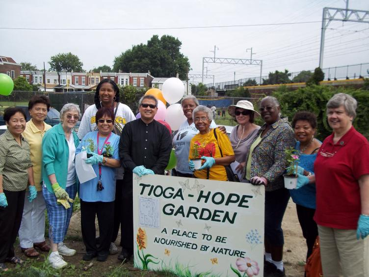 Tioga-Hope gardeners gather at the community plot they hope to buy from the city. (Photo courtesy of Tioga-Hope Garden)