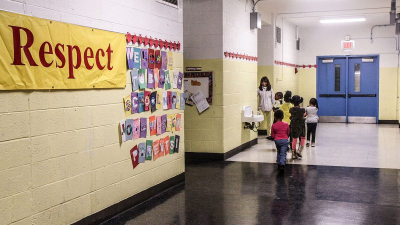 Students at Wister Elementary walk in single file to a class in October 2015. (Kimberly Paynter/WHYY)