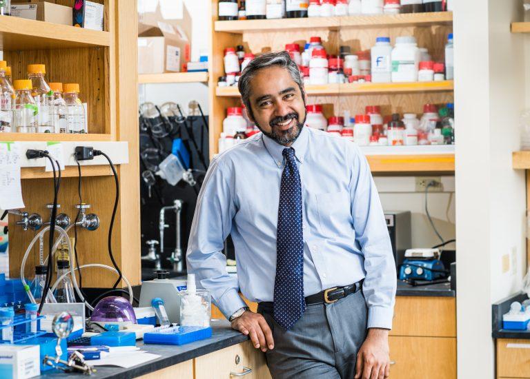 Muhammad Zaman, author of the book Bitter Pills: The Global War on Counterfeit Drugs, in his lab at Boston University. (Jackie Ricciardi/Boston University)