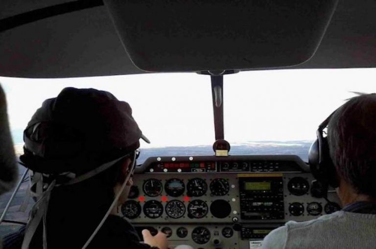 A pilot wears a wireless headband that tracks his brain activity, while flying a plane. Photo courtesy of ISAE-SUPAERO.