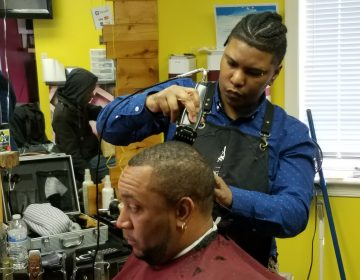 Delaware's master barber Lina Rosser shapes up her client in her Wilmington barber shop. (Andrea Gibbs/ WHYY)