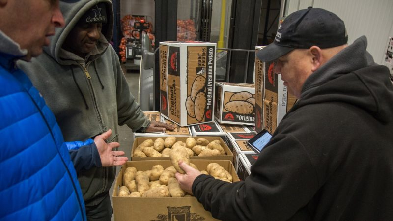 After searching for golden potatoes throughout the wholesale center, Jimmy finds exactly what he was looking for with trusted vendor Paul Giordano and Sons. (Emily Cohen for WHYY)