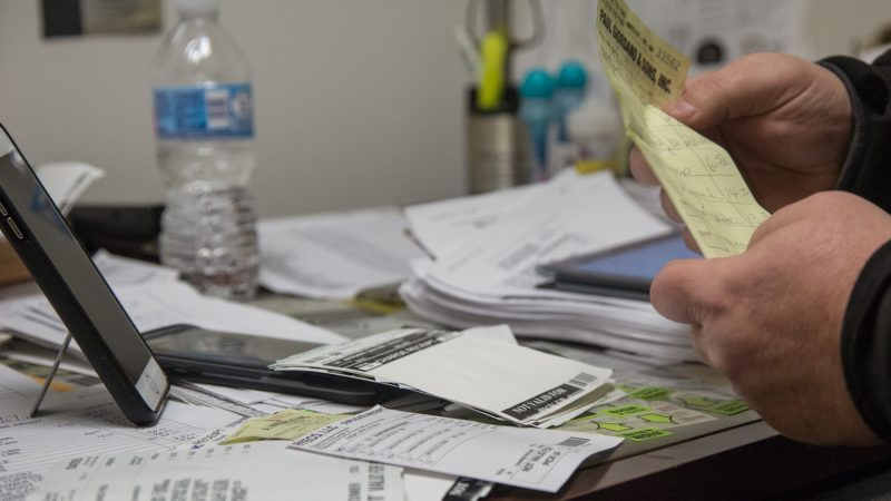 While Jimmy waits for his truck to arrive, he inputs his receipts into the Google document. (Emily Cohen for WHYY)