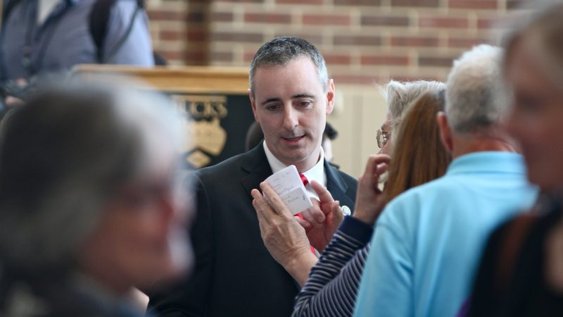 Pennsylvania 1st Congressional District incumbent Brian Fitzpatrick talks with supporters after a debate at Bucks County Community College. (Emma Lee/WHYY)