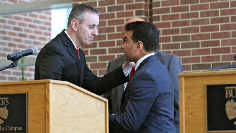 Republican congressional candidates, incumbent Brian Fitzpatrick (left) and Dean Malik, shake hands after a debate at Bucks County Community College. (Emma Lee/WHYY)