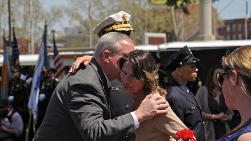 Philadelphia Mayor Jim Kenney greets a participant in the Living Flame Memorial Service. (Emma Lee/WHYY)