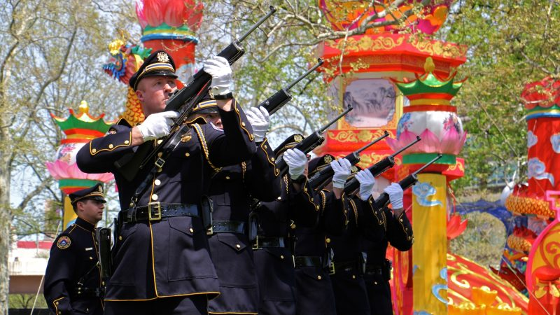 The Philadelphia Police and Fire Honor Guard fire a rifle salute in honor of fallen officers and firefighters. (Emma Lee/WHYY)