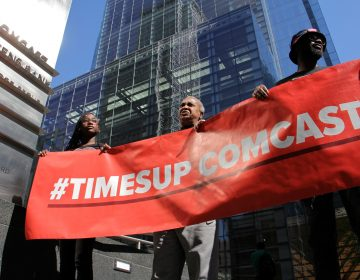 Protesters rally in support of women who say they were sexually harassed at Comcast call centers.