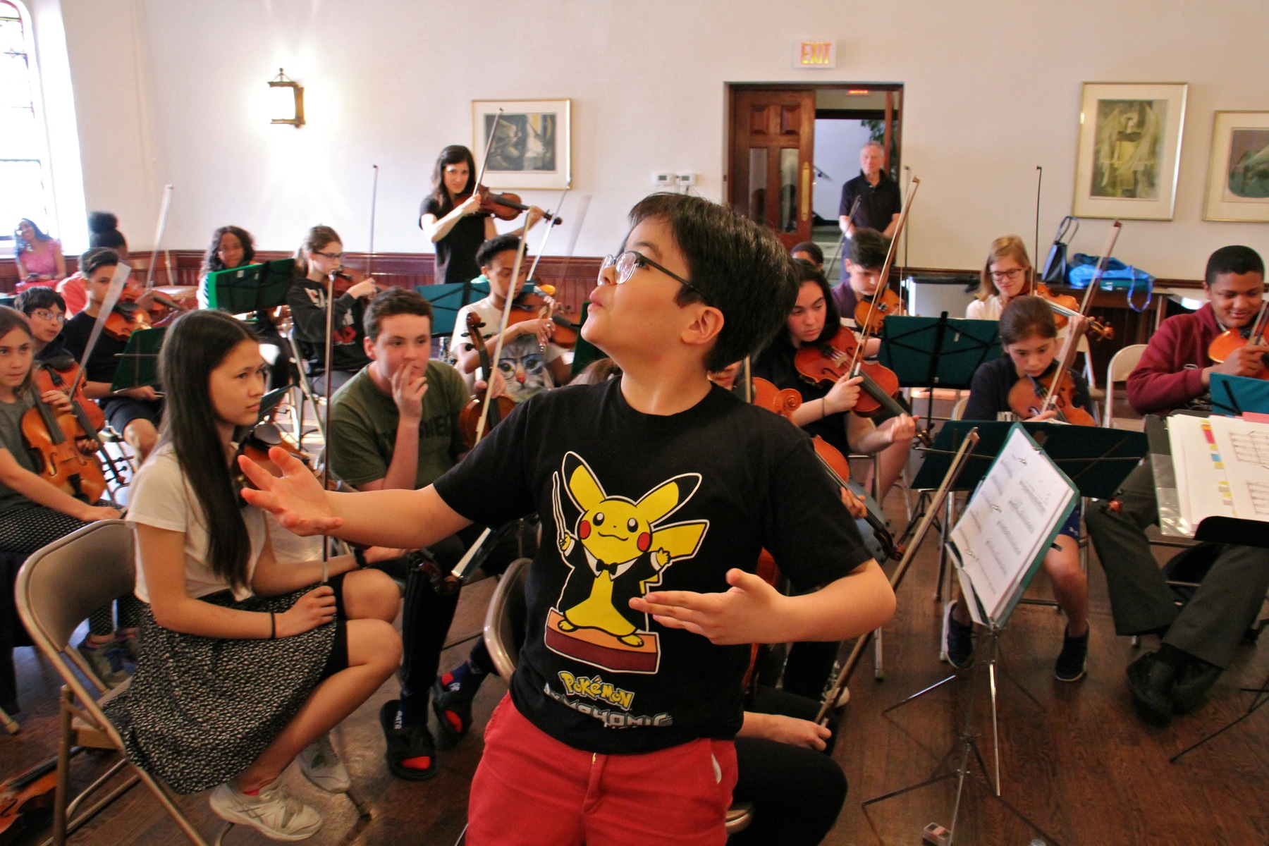 Cyrano Rosentrater, 10, whistles his part during a Musicopia rehearsal at the First Presbyterian Church in Philadelphia.