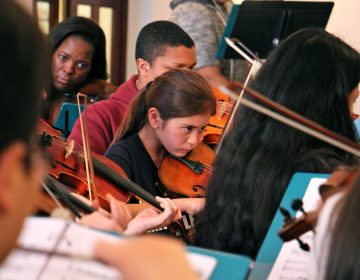 Meara Lim-Goyette, 11, (center) rehearses with Musicopia, for a performance of Mark Laycock's
