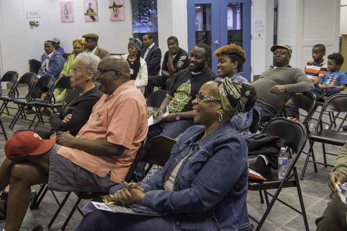 About two dozen people listen to community leaders discuss the legacy of Malcolm X. (Jonathan Wilson for WHYY)